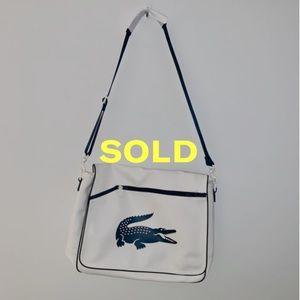 Lacoste leather messenger bag.